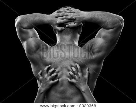 Monochrome Image Of A Man's Back And Woman's Hands