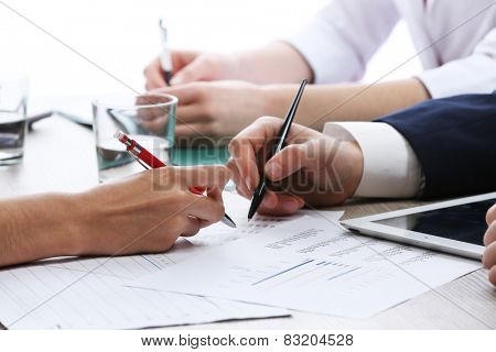 Meeting at worktable on white blurred background