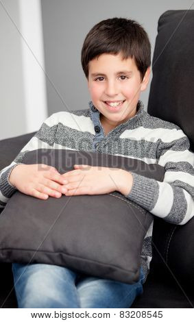 Smiling preteen on the sofa at home resting