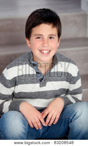 Preteen boy sitting on the stairs at home