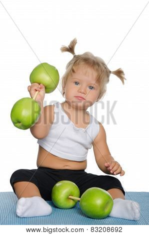 Little Girl With Weights Of Green Apples