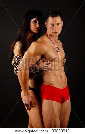 Muscular man poses with his girl