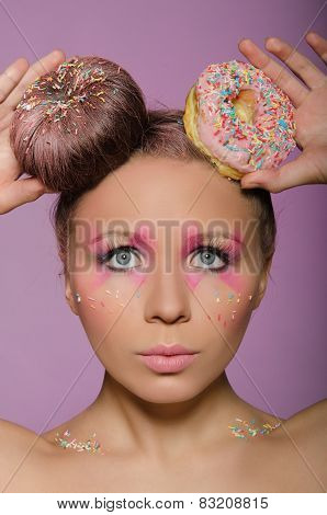 Beautiful Woman With Two Donuts On Head