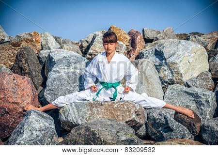 Young girl training karate