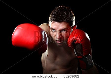 Aggressive Fighter Man Training Shadow Boxing With Red Fighting Gloves Throwing Vicious Right Punch