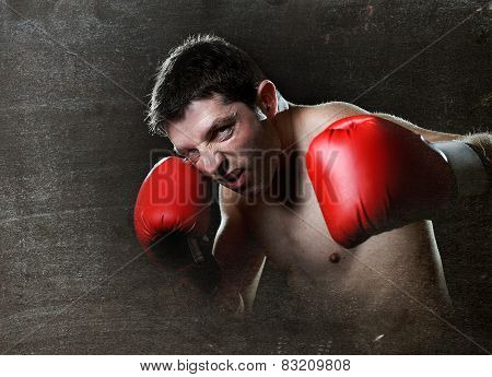Aggressive Fighter Man Training Shadow Boxing With Red Fighting Gloves Throwing Vicious Left Hook Pu