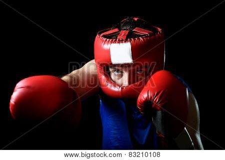 Amateur Boxer Man Fighting With Red Boxing Gloves And Headgear Protection