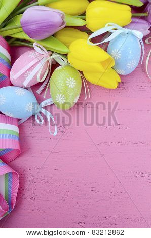Happy Easter Background With Painted Easter Eggs, Yellow And Purple Silk Tulips And Ribbon On Vintag