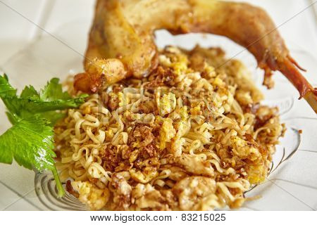 Instant fried noodle with scramble egg and fried chicken