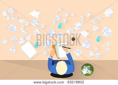 businessman pen write, crumpled papers around, problem concept