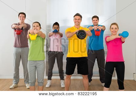 Group Of People Lifting Kettle Bell