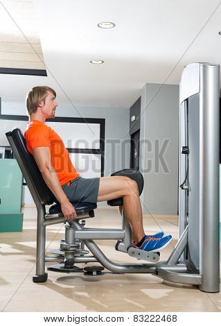 Hip abduction blond man exercise at gym indoor closing legs workout
