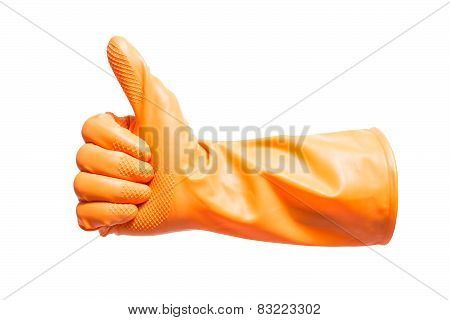 Thumbs up with a orange vinyl glove on white background with using path
