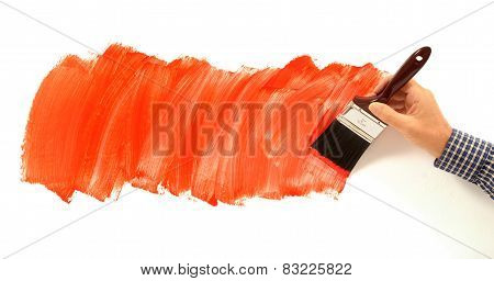 Man Painting Red Paint On White Wall