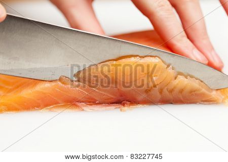 Cutting A Piece Of Fish For Sushi