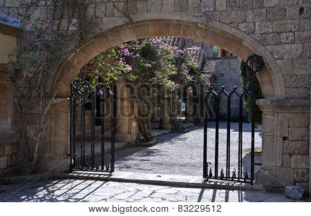 Gated Entrance To Courtyard At Ialyssos Monastery Rhodes