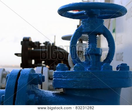 the blue valve on the pipeline