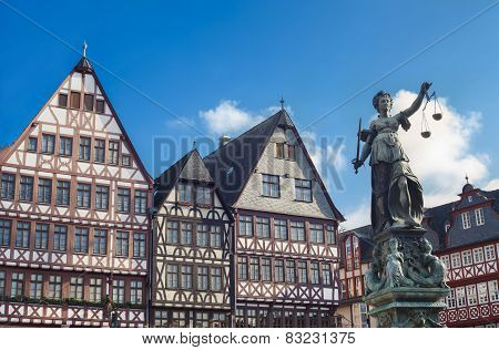 old buildings and statue of Lady Justice statue in Frankfurt