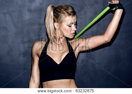 work out with rubber band, female caucasian model, trained body