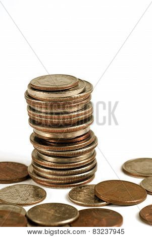 Stack Of Coins With Some Scattered