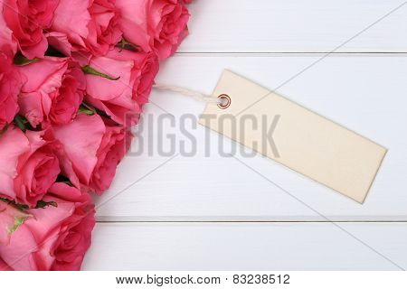 Roses Flowers On Valentine's Or Mother's Day With Greeting Card On A Wooden Board