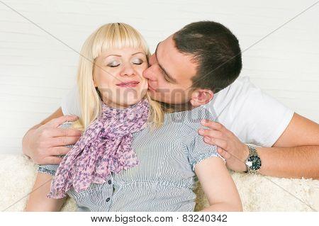 Man Kissing Pregnant Wife