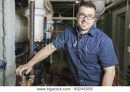 A good serviceman working on a machine room