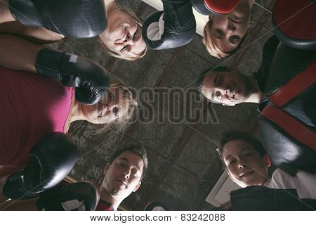 Boxing aerobox group with personal trainer man at fitness