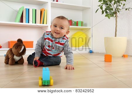 Smiling Baby Child Playing With Toys