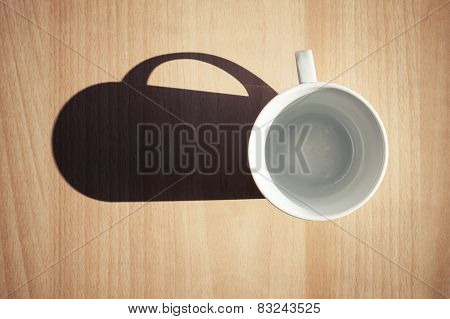 Empty White Coffee Cup On Wooden Table Background