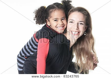 A family posing on a white background studio