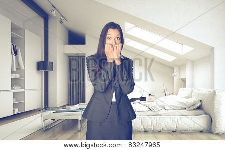 Shocked Office Woman in Business Suit inside an Architectural Room Looking at the Camera.