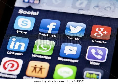 Close-up image of an iPhone screen with icons of social media apps