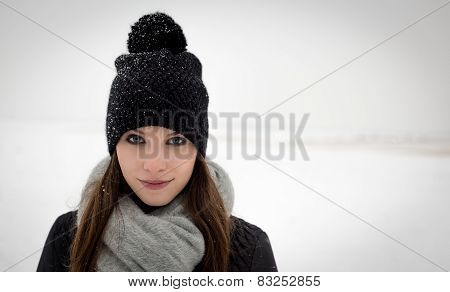 Outdoor portrait of a young girl in winter