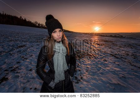 Spotlit portrait of a young girl in winter outfit
