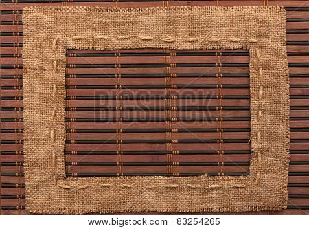 Frame Of Burlap, Lies On A Bamboo Mat