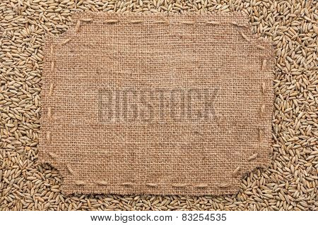 Figured Frame With Burlap And Stitches With  Place For Your Text Lying  On  Rye  Grains