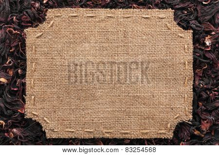 Figured Frame With Burlap And Stitches With  Place For Your Text Lying On Hibiscus