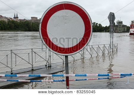 PRAGUE, CZECH REPUBLIC - JUNE 2, 2013: No entry for vehicles, a traffic sign on the embankment flooded by the swollen Vltava River in Prague, Czech Republic