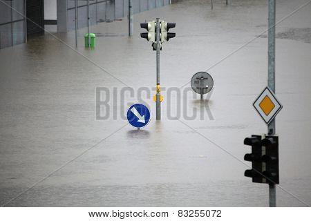 PRAGUE, CZECH REPUBLIC - JUNE 3, 2013: Flooded crossroad with traffic lights and a keep right traffic sign partially flooded by the swollen Vltava River in Prague, Czech Republic.