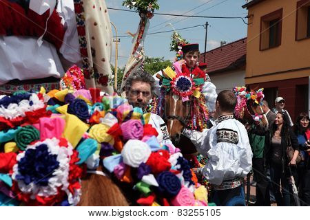 VLCNOV, CZECH REPUBLIC - MAY 26, 2013: Young men dressed in Moravian folk costume ride decorated horses to perform the Recruits during the Ride of the Kings festival in Vlcnov, Moravia, Czech Republic
