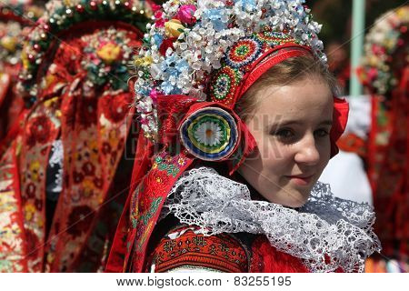 VLCNOV, CZECH REPUBLIC - MAY 26, 2013: Young women dressed in traditional Moravian folk costumes attend the Ride of the Kings folklore festival in Vlcnov, South Moravia, Czech Republic.