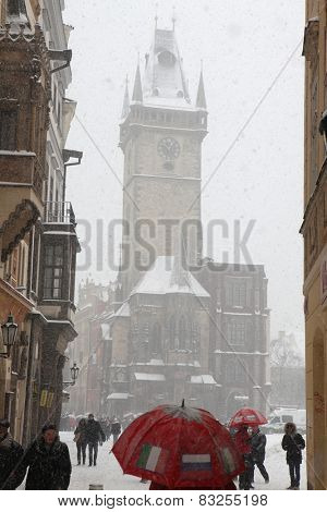 PRAGUE, CZECH REPUBLIC - FEBRUARY 23, 2013: Heavy snowfall covering the Old Town Hall on Old Town Square in Prague, Czech Republic.