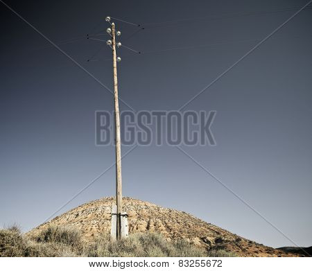 Wooden pylon with blue and clear sky