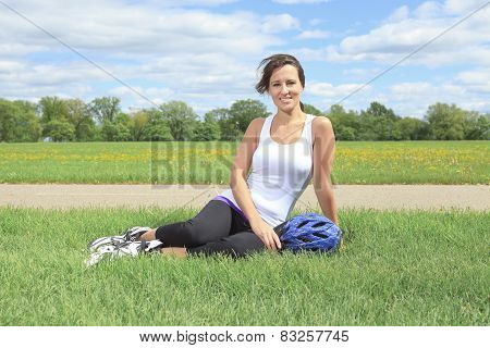 A Roller skating girl in park rollerblading on inline skates.