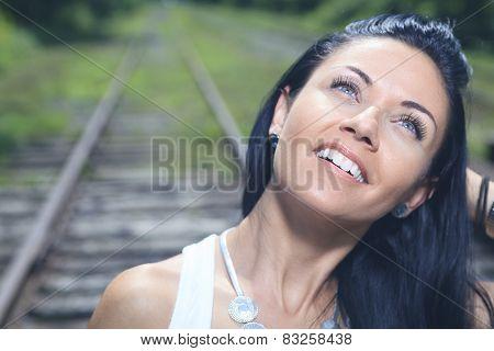 A fashion woman on the railroad train.