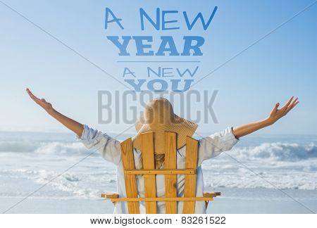 Woman relaxing in deck chair by the sea against new year new you