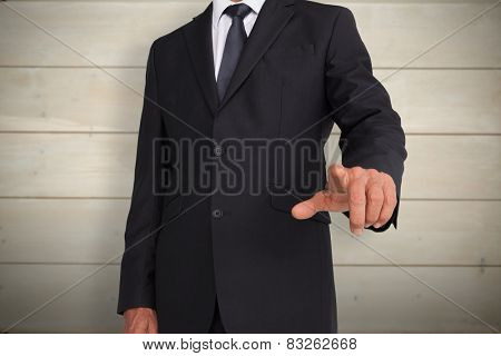 Businessman pointing against bleached wooden planks background