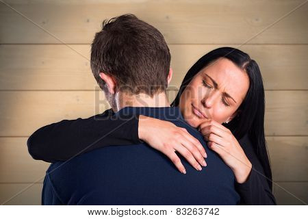 Woman breaking up with boyfriend against bleached wooden planks background