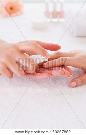 Applying Antiseptic On Nails.